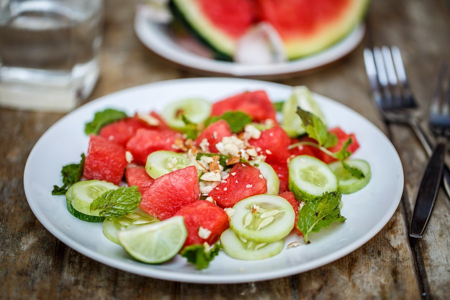 Watermelon salad with cucumbers on the board